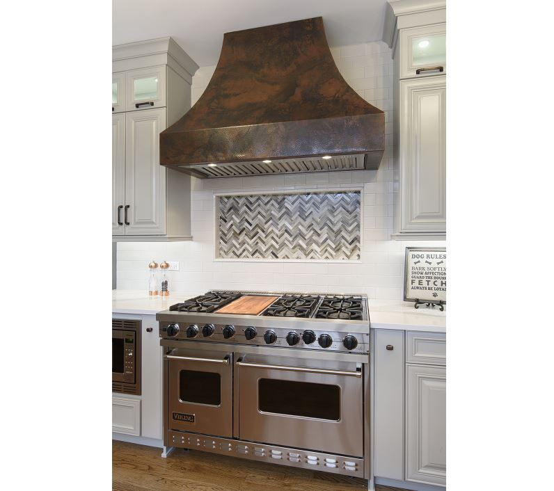 Custom Hood And Intricate Tile Work Make This Kitchen Remodel Cook